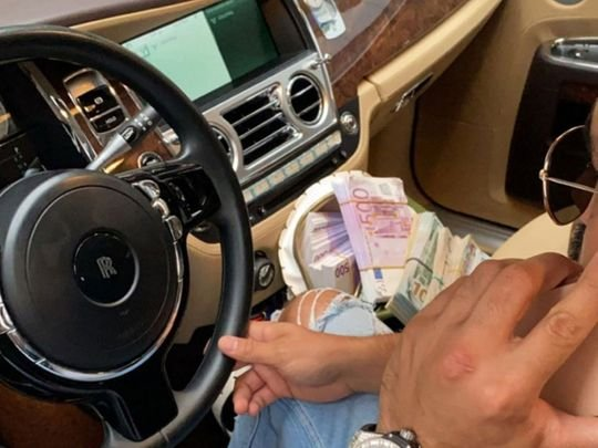 Dubai man throws fake cash from car in viral video; jailed, fined Dh200,000